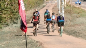 Cyclists cruise down the Legacy Trail, a bike path that now connects Canmore to Banff. (CBC)